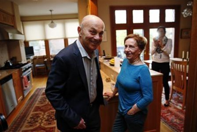University of Chicago Professor Eugene Fama is pictured in his house with his wife Sally after finding out he won the 2013 Nobel Prize in Economics in Chicago, Illinois.