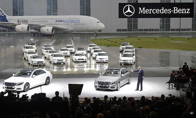 Dieter Zetsche, CEO of German carmaker Daimler, presents Mercedes-Benz S-class cars in front of an Airbus A380 during the presentation at the Airbus plant in Hamburg-Finkenwerder, Germany.