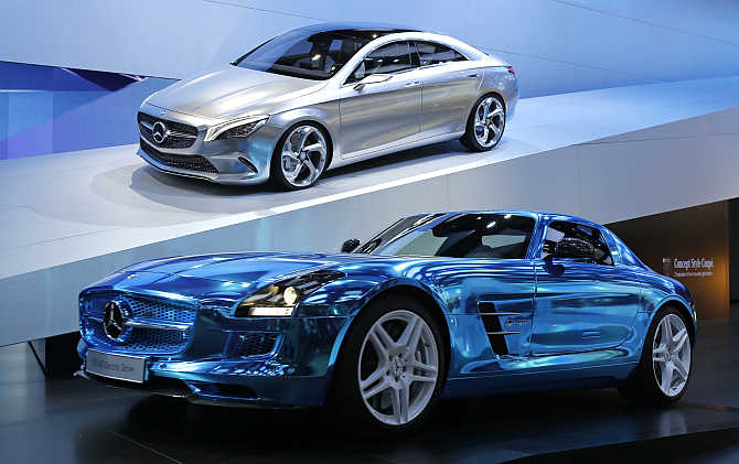 Mercedes-Benz Concept Style Coupe, up, model and a Mercedes-Benz SLS AMG Electric Drive model on display in Paris.