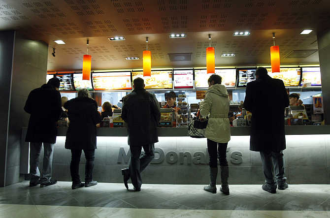 Customers buy food at a McDonald's restaurant in Moscow, Russia.