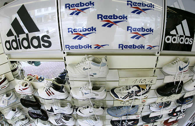 Sport shoes are displayed in a store in the northern German town of Hamburg.