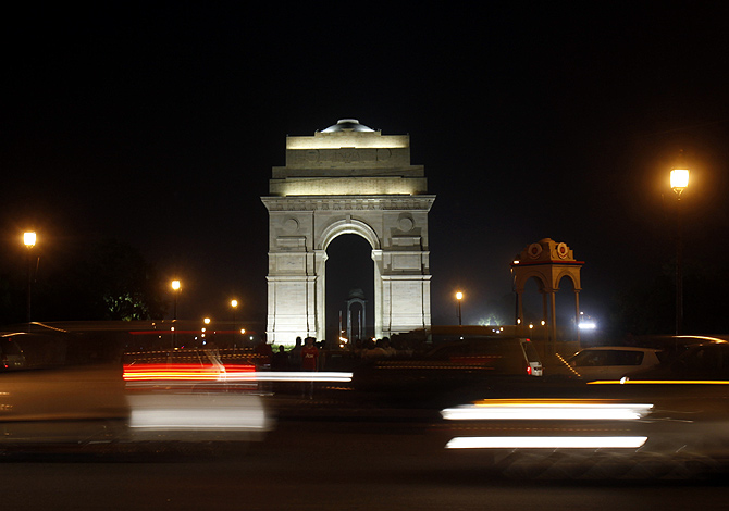 Traffic moves in front of the India Gate before Earth Hour in New Delhi.