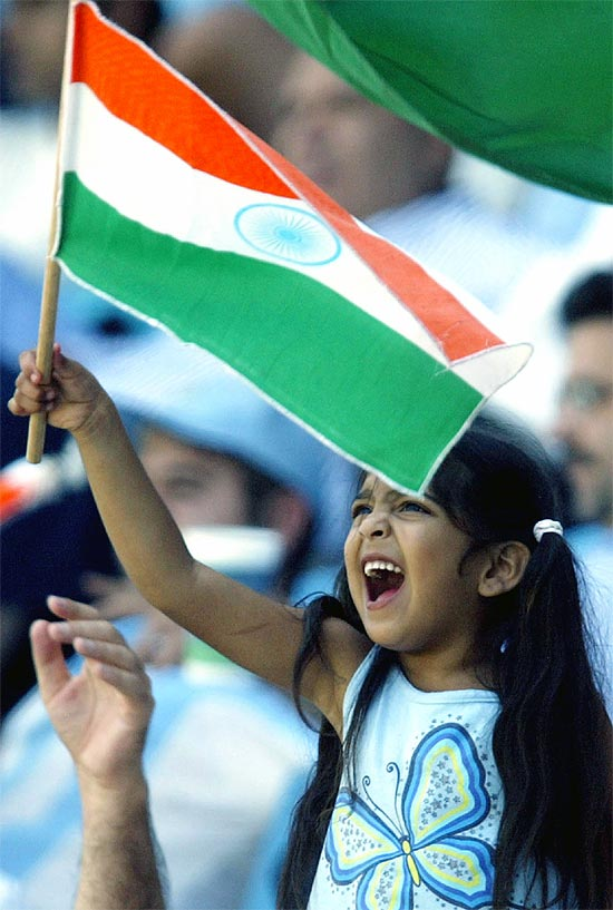 An Indian child waves the national flag.