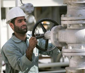 An Iranian oil worker on the Persian Gulf coast. Photograph: Morteza Nikoubazl/Reuters