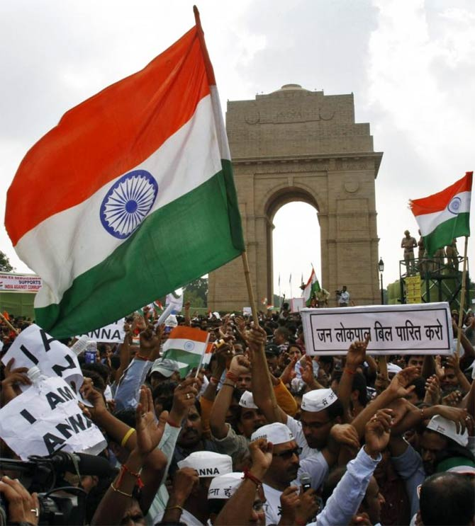 Protestors shout slogans at India Gate, New Delhi.