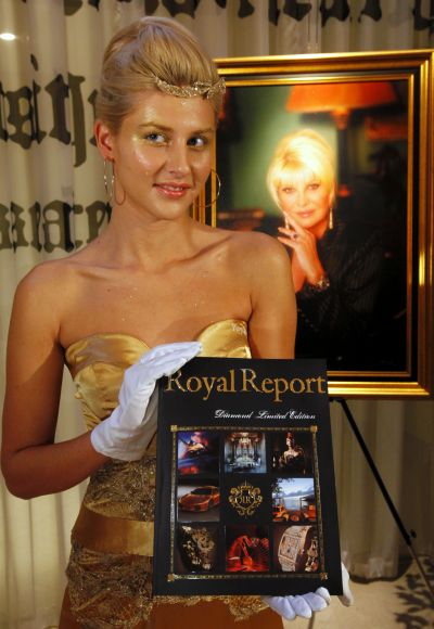 A model poses with a special edition of luxury magazine Royal Report in Prague.