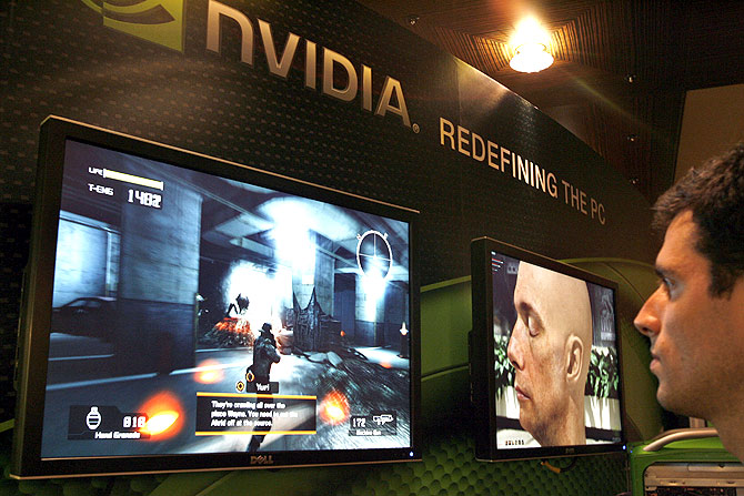 A sales man demonstrates a computer game in a display area of Nvidia Corp. during the second day of the annual Computex Taipei.