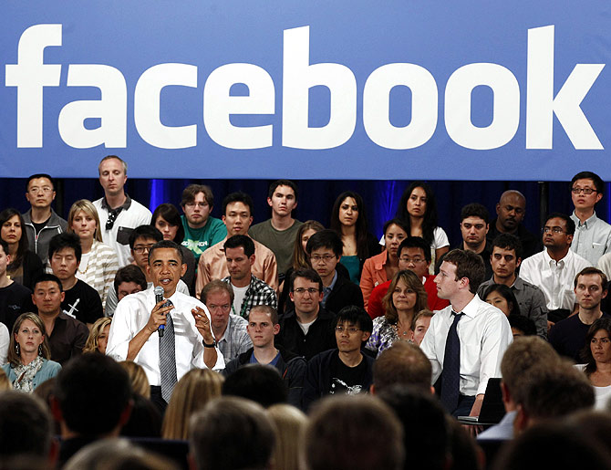 U.S. President Barack Obama attends a town hall meeting at Facebook headquarters with CEO Mark Zuckerberg in Palo Alto.