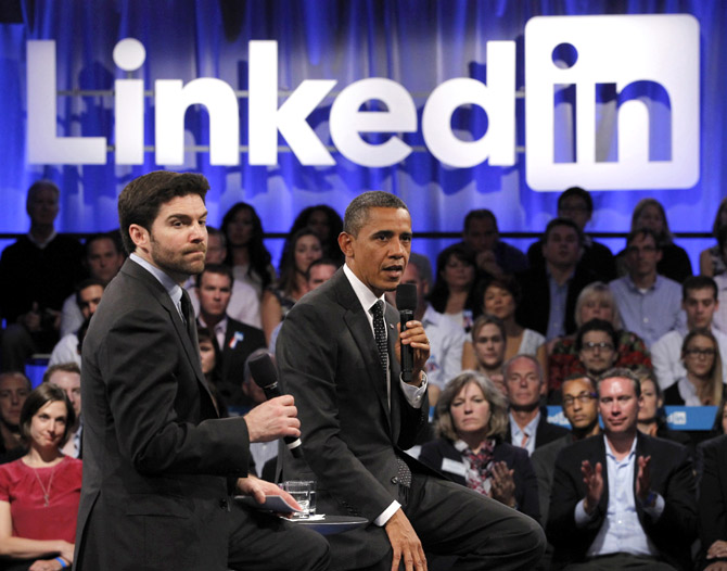 US President Barack Obama participates in a LinkedIn town hall-style meeting with Linked In CEO Jeff Weiner (L) in Mountain View, California.