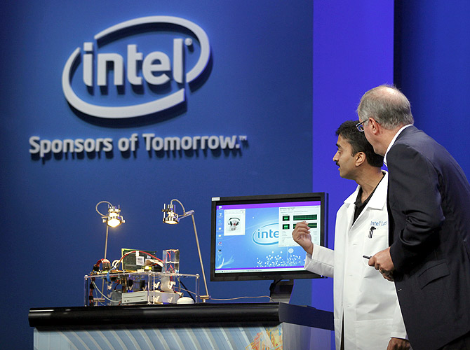 Intel CEO Paul Otellini looks over a prototype solar-powered computer during his keynote address at the Intel Developers Forum in San Francisco.