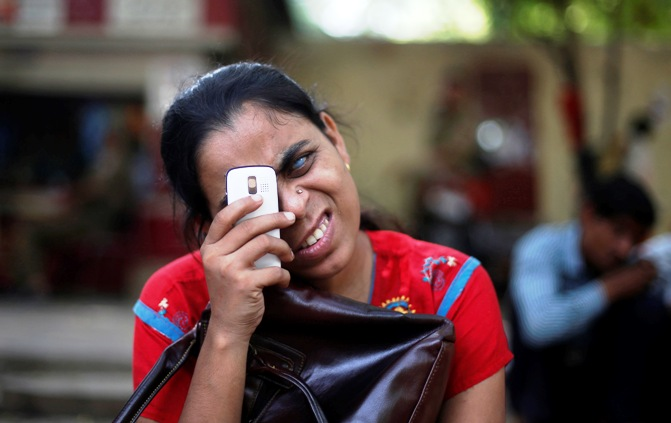 A visually impaired girl uses her mobile during a protest in New Delhi.