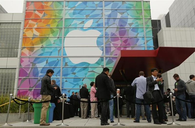 People line up for the Apple event at the Yerba Buena centre in San Francisco, California.