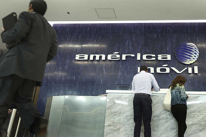 Logo of America Movil on the wall of the reception area in the company's corporate offices in Mexico City.
