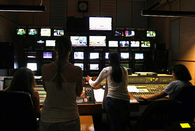 Employees of state broadcaster ERT work in the master control room of the station in Athens during a live broadcast, Greece. Tata Communica