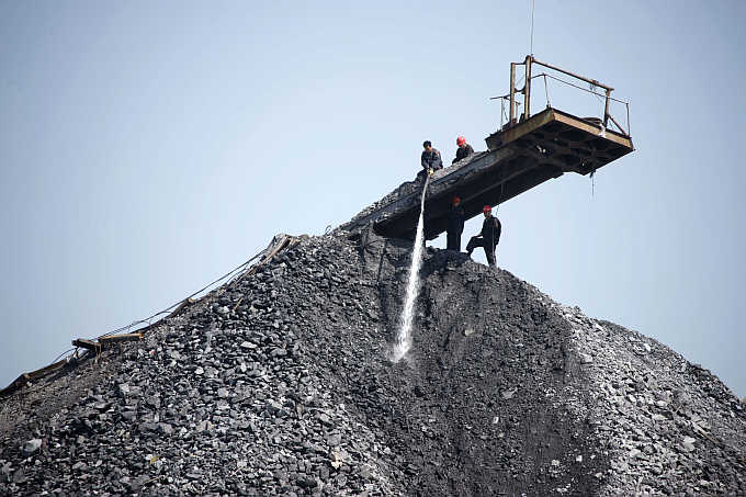 Employees work on a pile of coal gangue in Huaibei, Anhui province, China. Bumi Resources is the biggest thermal coal producer in Indonesia. Photos is for representation purpose only.