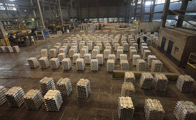 Workers store aluminium ingots at the Rusal Krasnoyarsk aluminium smelter in the Siberian city of Krasnoyarsk, Russia.
