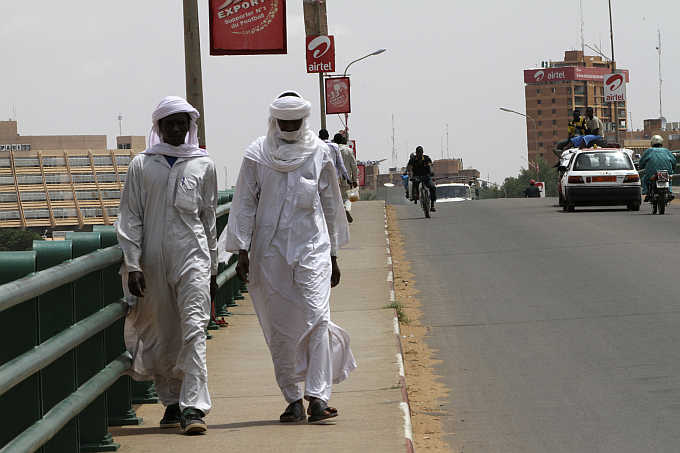 People walk along Kennedy Bridge in Niamey, capital city of Niger.