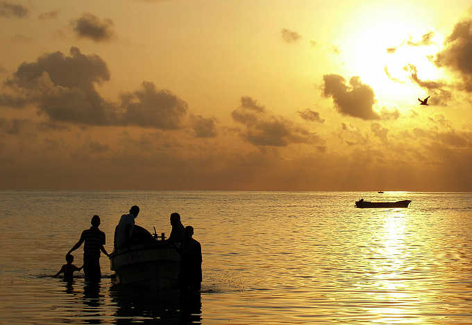 Fishermen slip away at dawn from the harbour in Obock town in Djibouti.