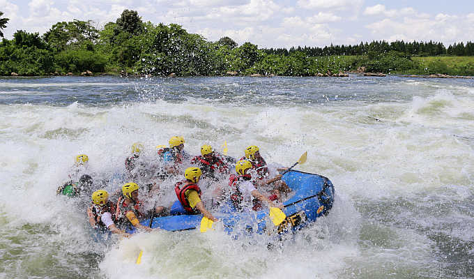 Tourists paddle their raft during white water rafting at Itanda falls on the River Nile near Jinja district, 109km east of the Ugandan capital of Kampala.
