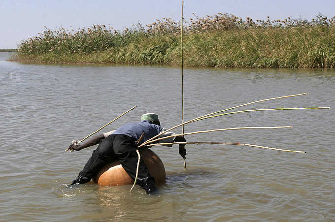 A man fishes using the traditional kalabash method in the Lake Region near the town of Bol in Chad.