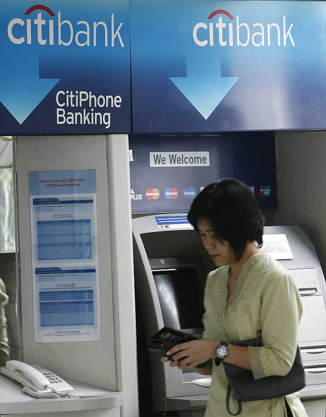 A customer leaves Citibank's automated teller machine in Jakarta, Indonesia.