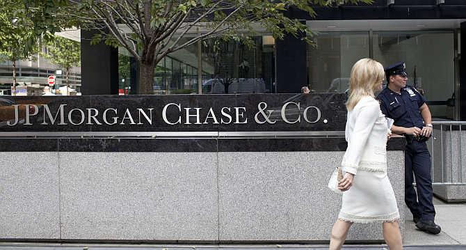A woman walks past JPMorgan Chase's international headquarters on Park Avenue in New York City.