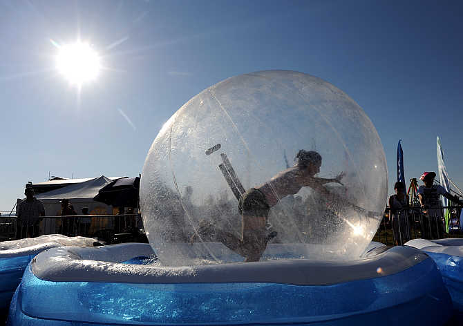 A reveller runs in a water ball during the Pohoda music festival at Trencin airport, 130km north of Bratislava, Slovakia.