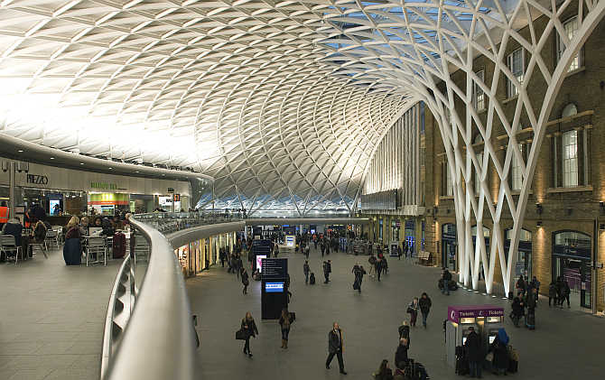 Passengers walk through King's Cross station in London, United Kingdom.