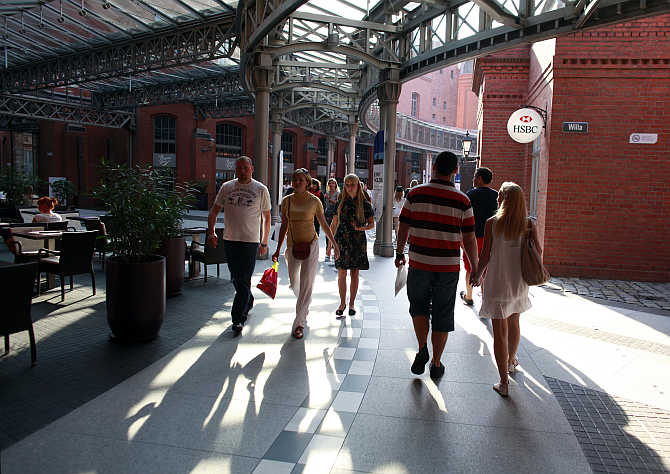 People walk at the Stary Browar shopping centre in Poznan, western Poland.