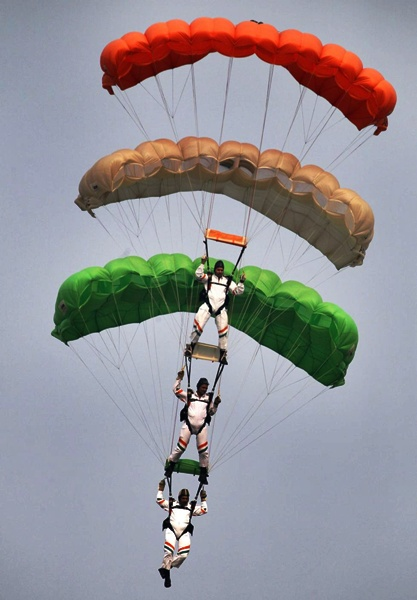 Indian Air Force sky divers form the Indian tri-colour at Hindon airport in Ghazia