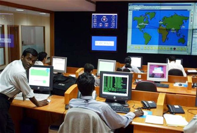 Engineers work in the control room at Infosys Technologies campus.