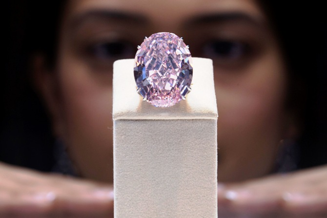 A model poses with the Pink Star diamond during a press preview at Sotheby's in Hong Kong.
