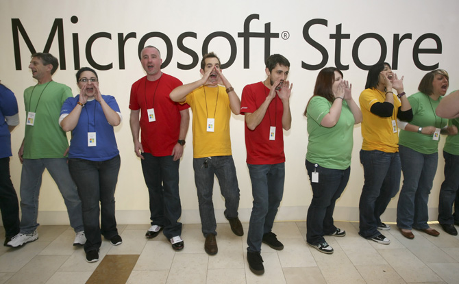 Employees of the new Microsoft Store cheer to a waiting crowd of more than 2,000 people before opening the store in Bellevue, Washington.