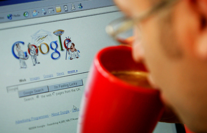 An internet surfer views the Google home page at a cafe in London