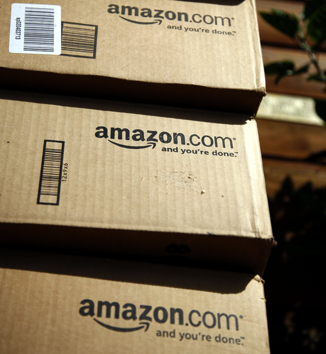 A stack of boxes from Amazon.com are pictured on the porch of a house in Golden, Colorado.
