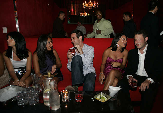 Clubbers take a break from dancing in the Red Room at the Pure nightclub inside Caesars Palace hotel-casino in Las Vegas, Nevada, United States.