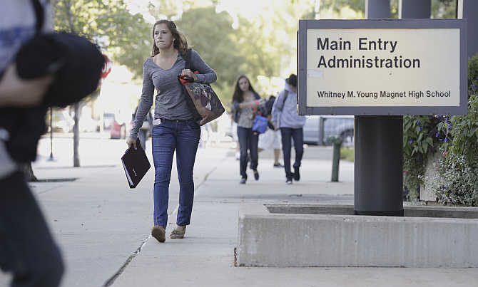 Students make their way to Whitney Young High School in Chicago, United States.