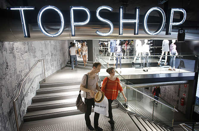 Shoppers exit a Topshop store in Sydney, Australia.