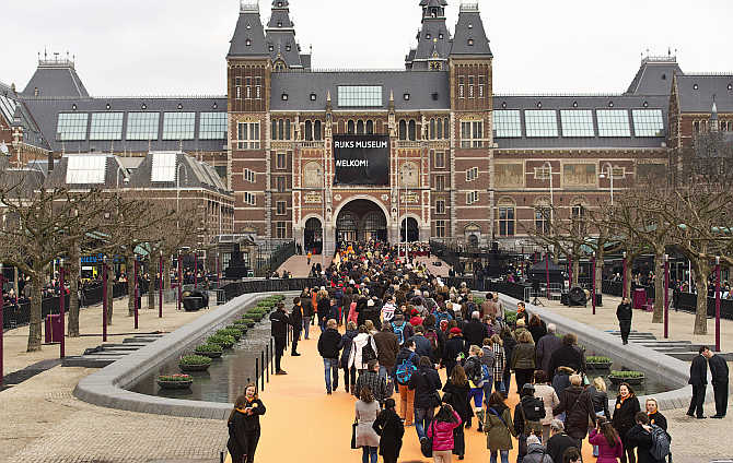 Visitors enter the Rijksmuseum in Amsterdam, the Netherlands.