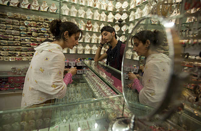 A woman buys jewellery in Islamabad, Pakistan.