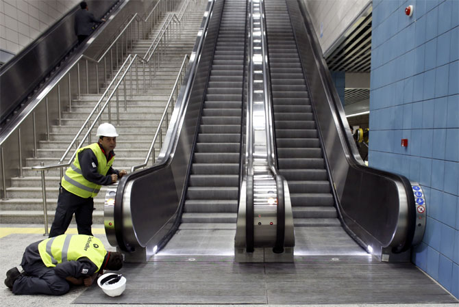 Engineers perform the last checks on escalators of a station of Marmaray, a subway which links Europe with Asia some 60 metres below the Bosphorus Strait.
