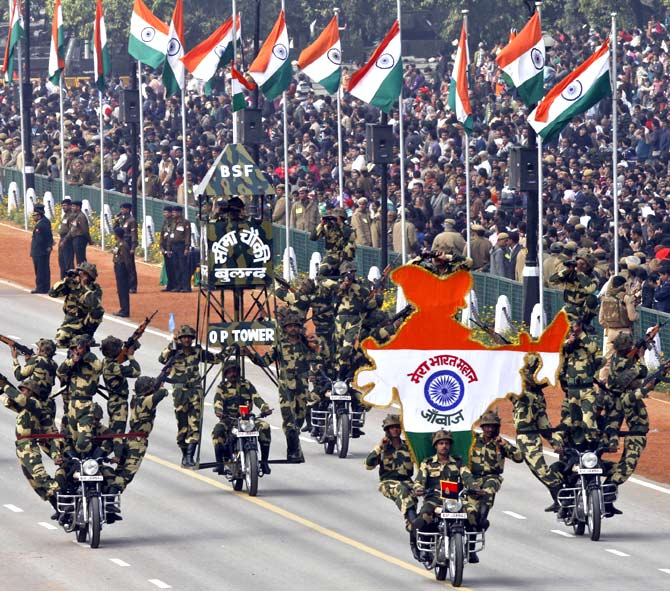 India's Border Security Force (BSF) Daredevils motorcycle riders perform as Republic Day parade in New Delhi