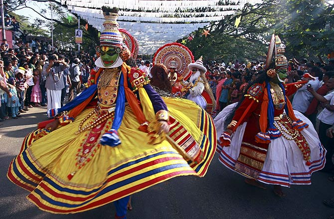 Indian folk dancers perform during the 28th Cochin Carnival at Fort Kochi in the southern Indian city of Kochi.