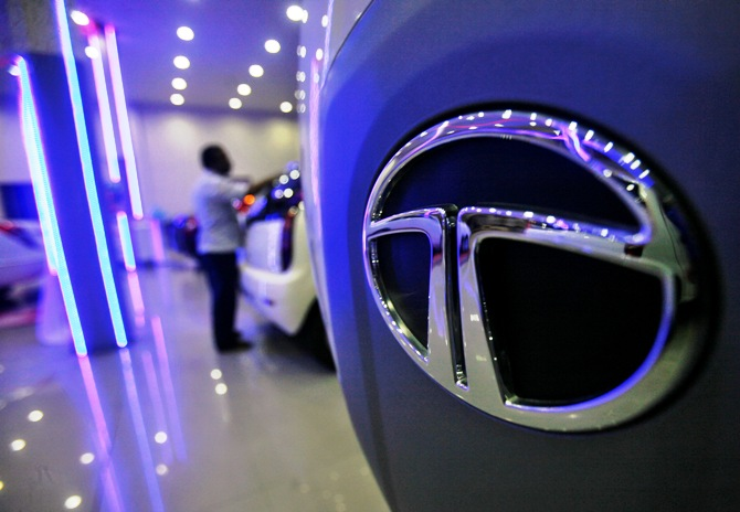A worker cleans a Tata Motors vehicle inside the company's showroom on the outskirts of Agartala.