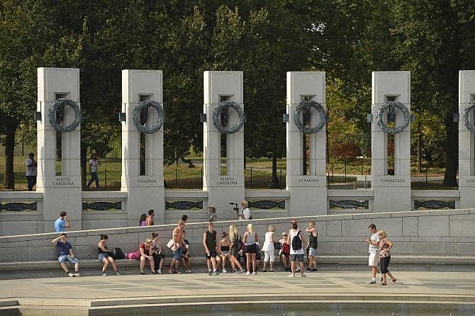 Tourists visit the World War II Memorial in Washington, DC, United States.