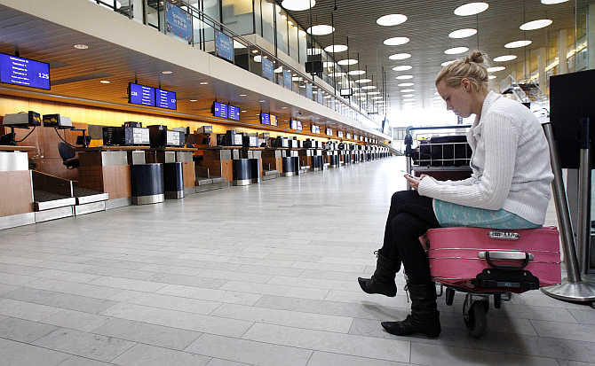 Christina Klarskov Pedersen waits for her flight to Spain after volcanic ash from an Icelandic volcano closed Copenhagen's Kastrup Airport, Denmark.
