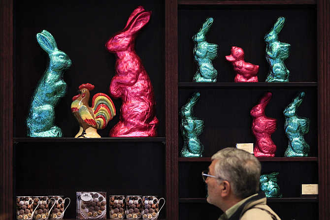 A man watches chocolate bunnies for Easter at a shop of Fassbender & Rausch chocolate maker at Berlin's Gendarmenmarkt square, Germany.