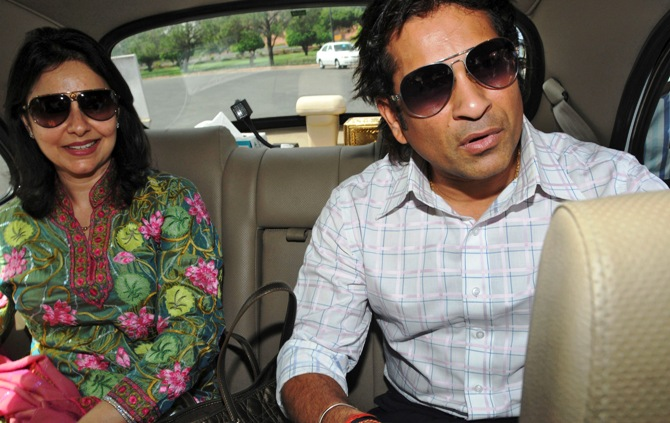 Sachin Tendulkar, along with his wife Anjali, arrives at the Indian parliament to be sworn in as a member of parliament in New Delhi.