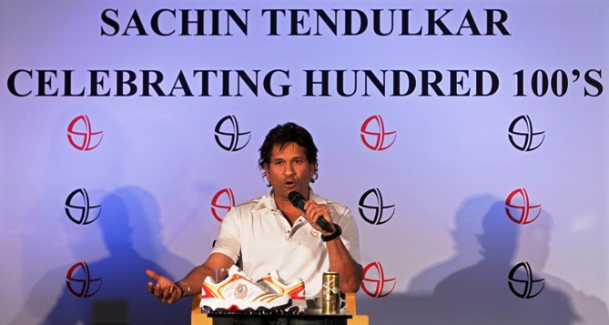 Sachin Tendulkar speaks during a news conference held to celebrate becoming the first player in history to score 100 centuries, in Mumbai March 25, 2012.
