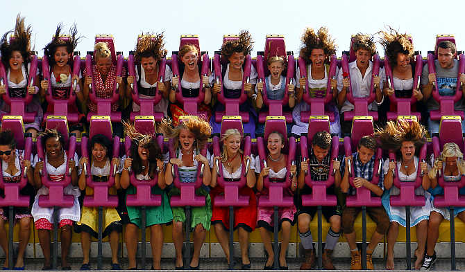 Revellers enjoy a ride in a roller coaster after the opening of the world's biggest beer fest, the Munich Oktoberfest, at the Theresienwiese in Munich, Germany.